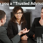 A trusted advisor speaking to a couple of prospective customers